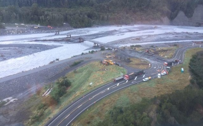 Work being done on the Waiho bridge following the March floods. Photo: Supplied via RNZ