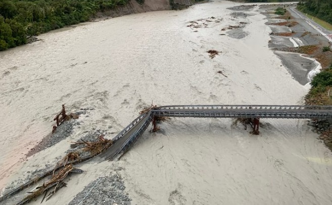 The Waiho Bridge was washed away in floodwaters on Tuesday. Photo: Doc