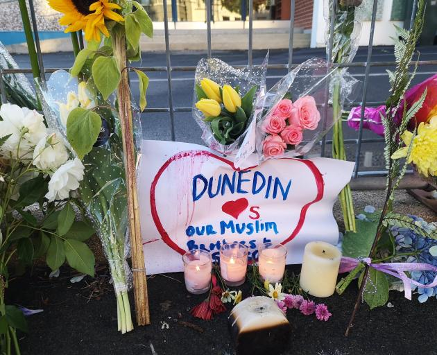Flowers left outside the Dunedin mosque after the Christchurch shootings. Photo: Vaughan Elder