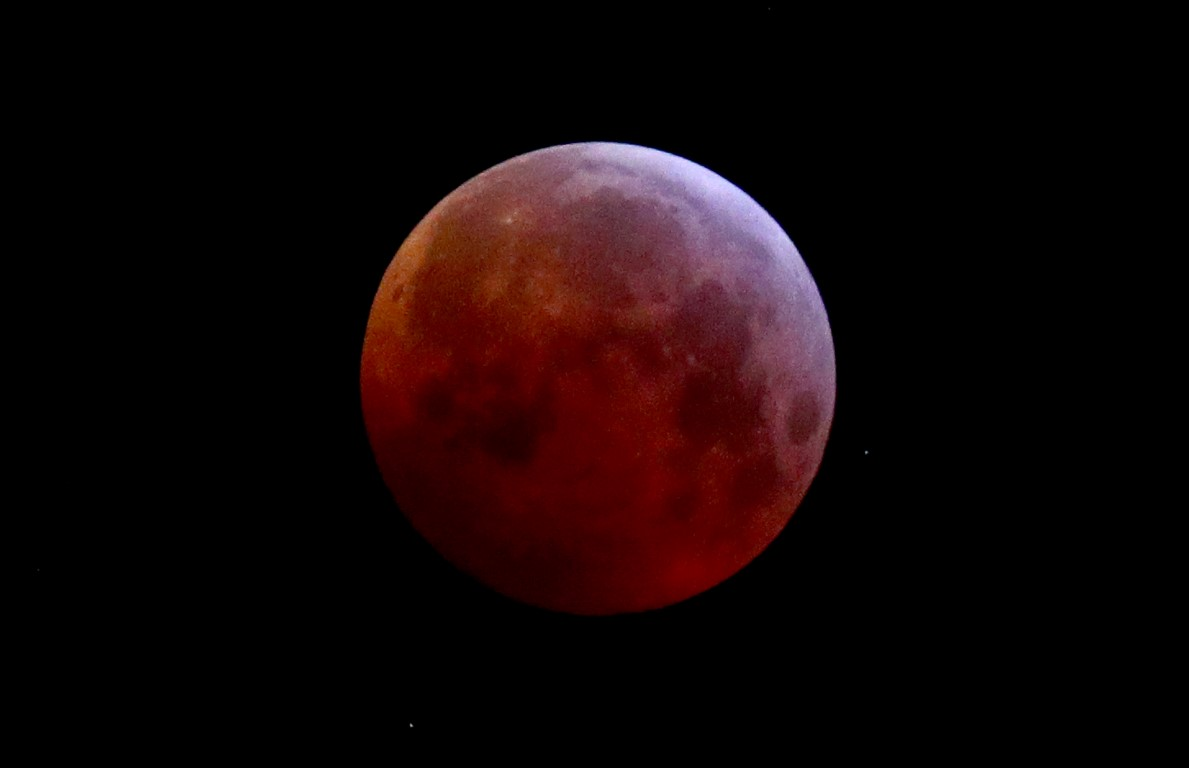 The moon is covered by the earth's shadow during a total lunar eclipse over Vienna, Austria,...