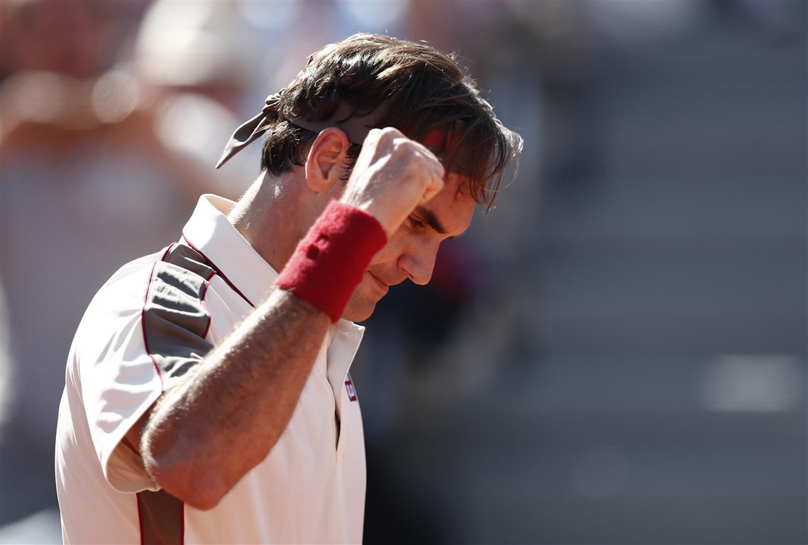 Roger Federer reacts after winning after his third round match against Casper Ruud. Photo: Reuters
