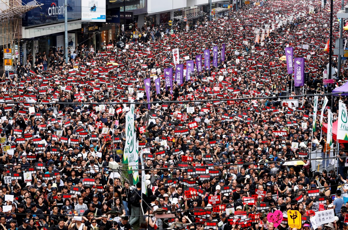 Protesters turned out in huge numbers in Hong Kong to demand the leaders step down and withdraw...