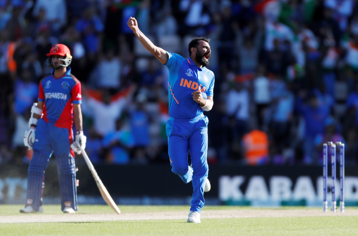 India's Mohammed Shami celebrates taking the wicket of Afghanistan's Aftab Alam. Photo: Reuters