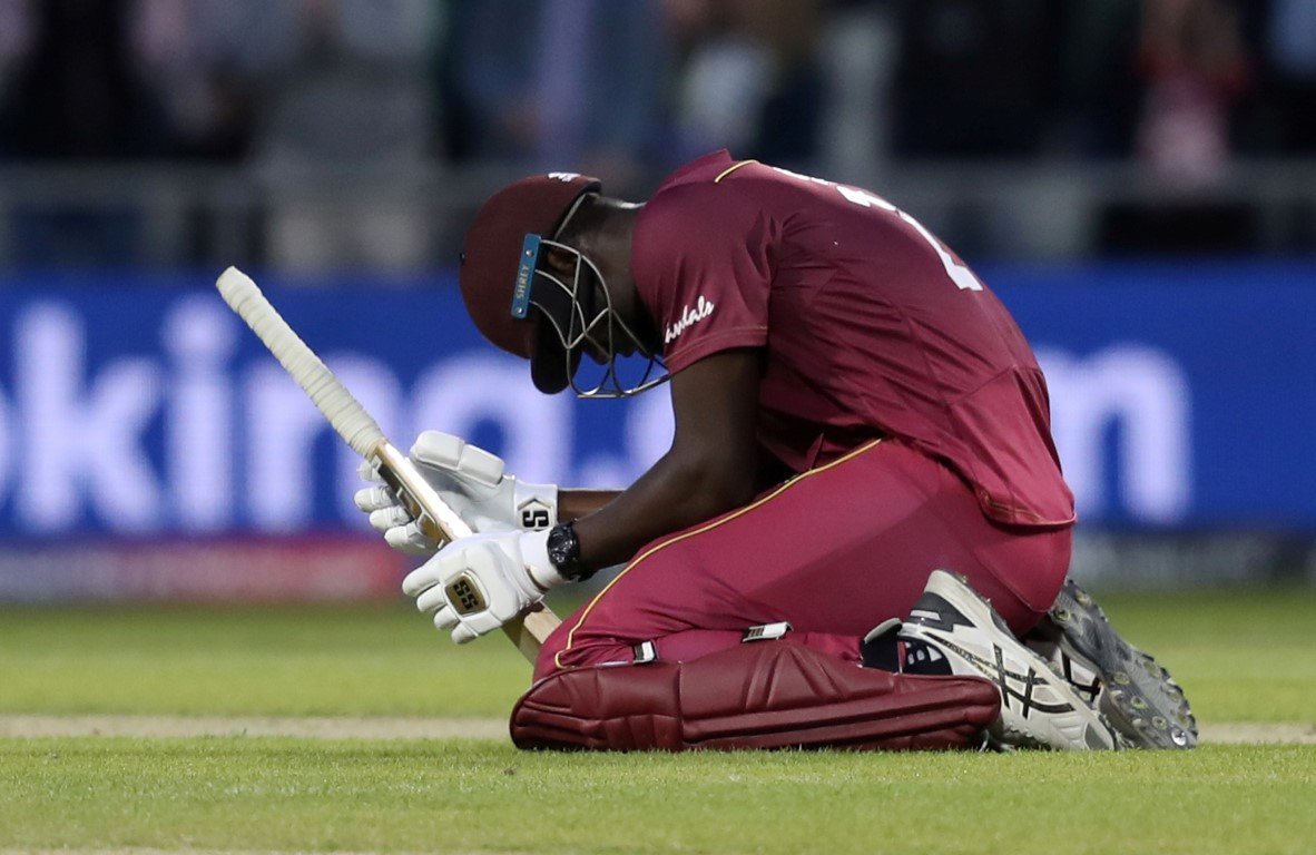 A dejected Carlos Brathwaite after being dismissed by New Zealand. Photo: Reuters