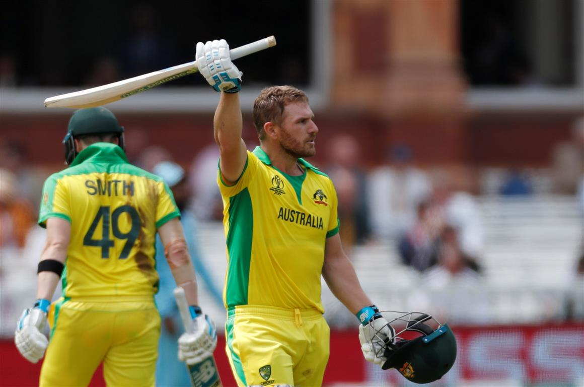 Australia's Aaron Finch celebrates reaching his century. Photo: Reuters