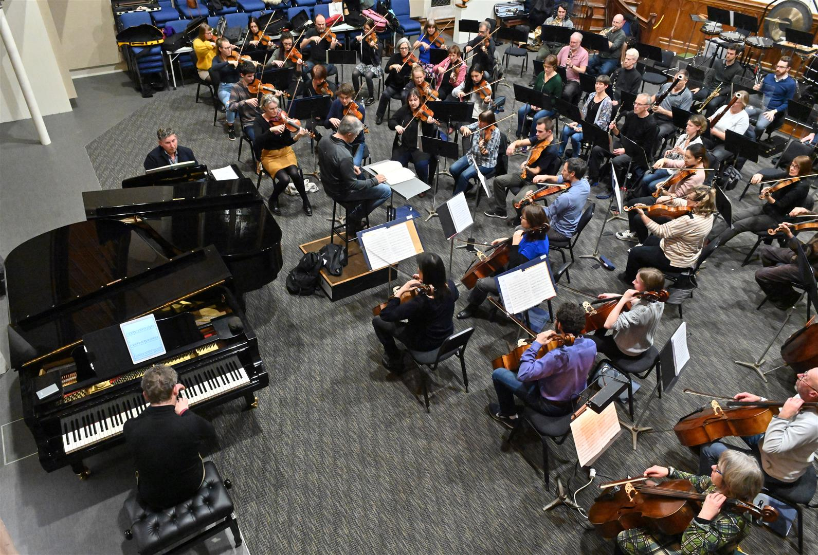 Pianists Terence Dennis (facing camera) and Tom McGrath rehearse with the Dunedin  Symphony Orchestra  at Hanover Hall on Tuesday night. Photo: Linda Robertson