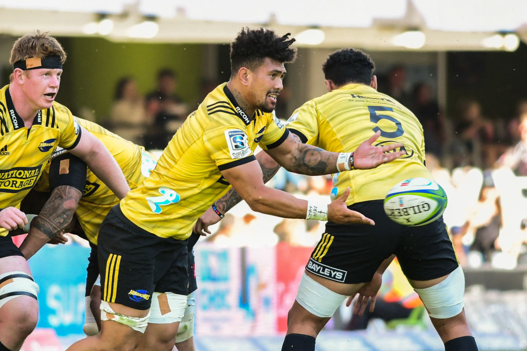 Ardie Savea of the Hurricanes gets a pass away against the Sharks. Photo: Getty