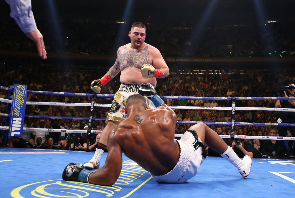 Andy Ruiz Jr knocks down Anthony Joshua during their IBF/WBA/WBO title fight at Madison Square...