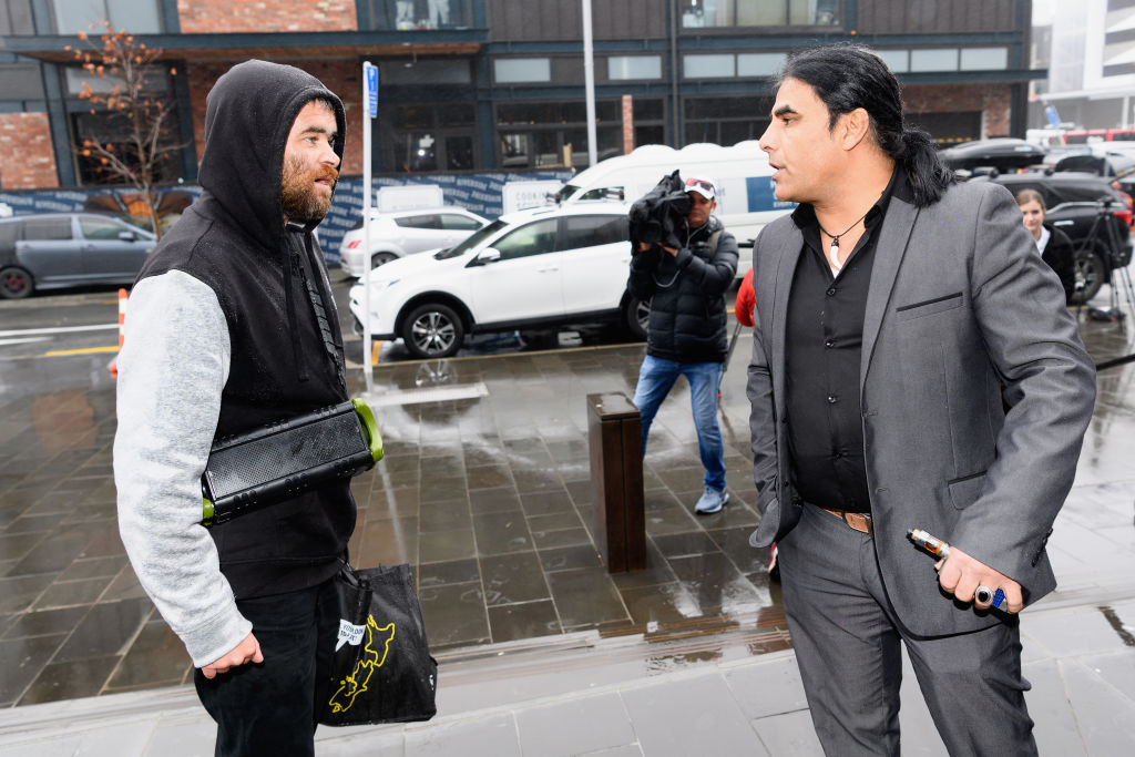 Abdul Aziz (R) confronts a member of the public who backed white supremacist views in front of...