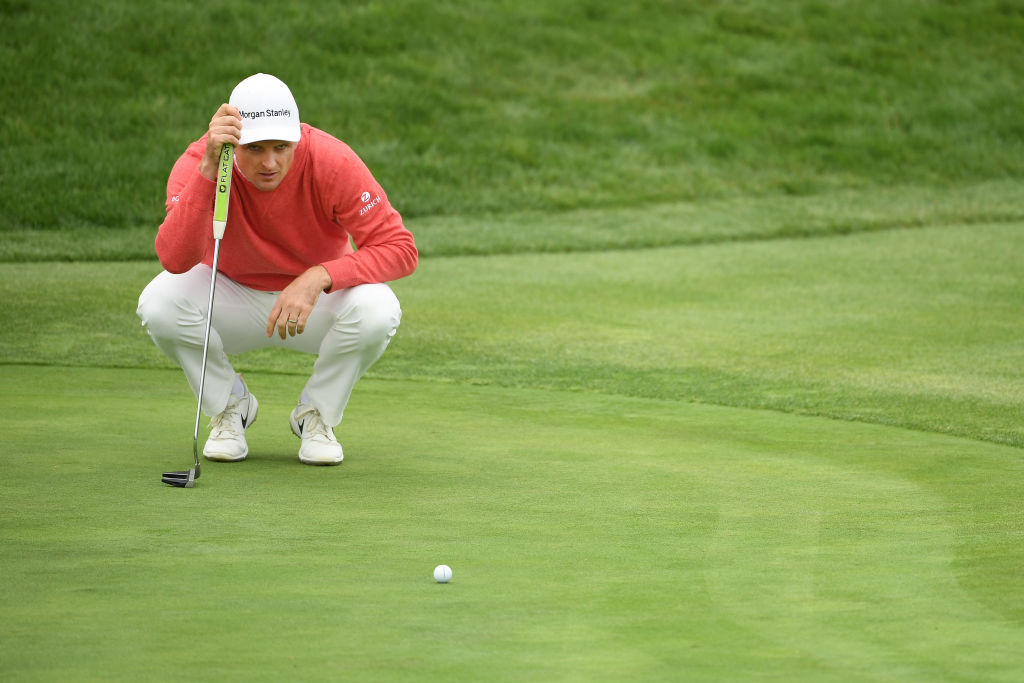 Justin Rose lines up a putt on the 12th green. Photo: Getty