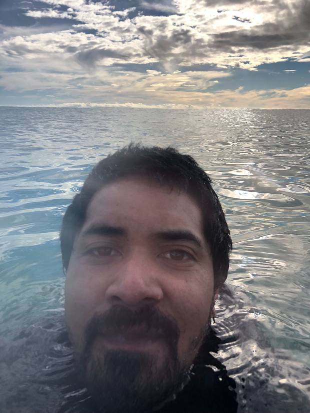Remopita Pongi, 29, snaps a selfie after an attempted shortcut left him floating adrift at sea in...
