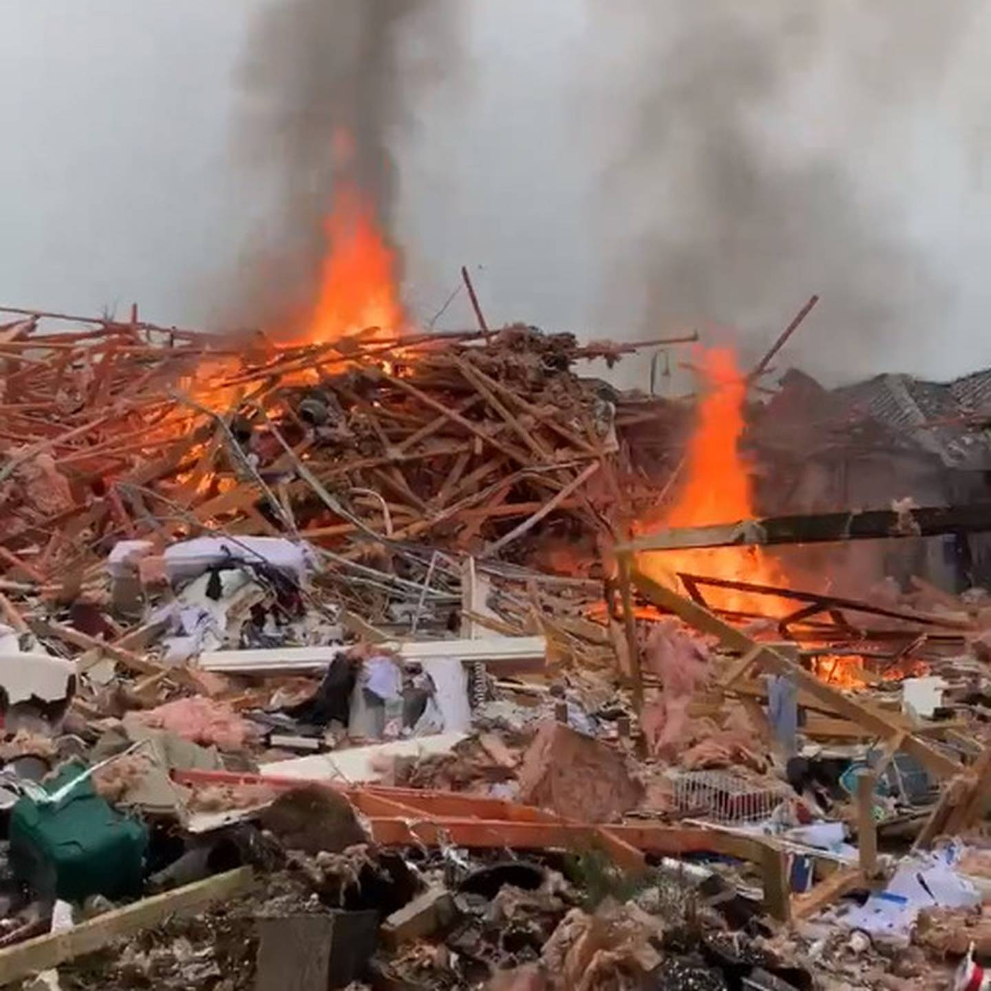 The blast destroyed one house and injured several people. Photo: James Looyer via NZ Herald
