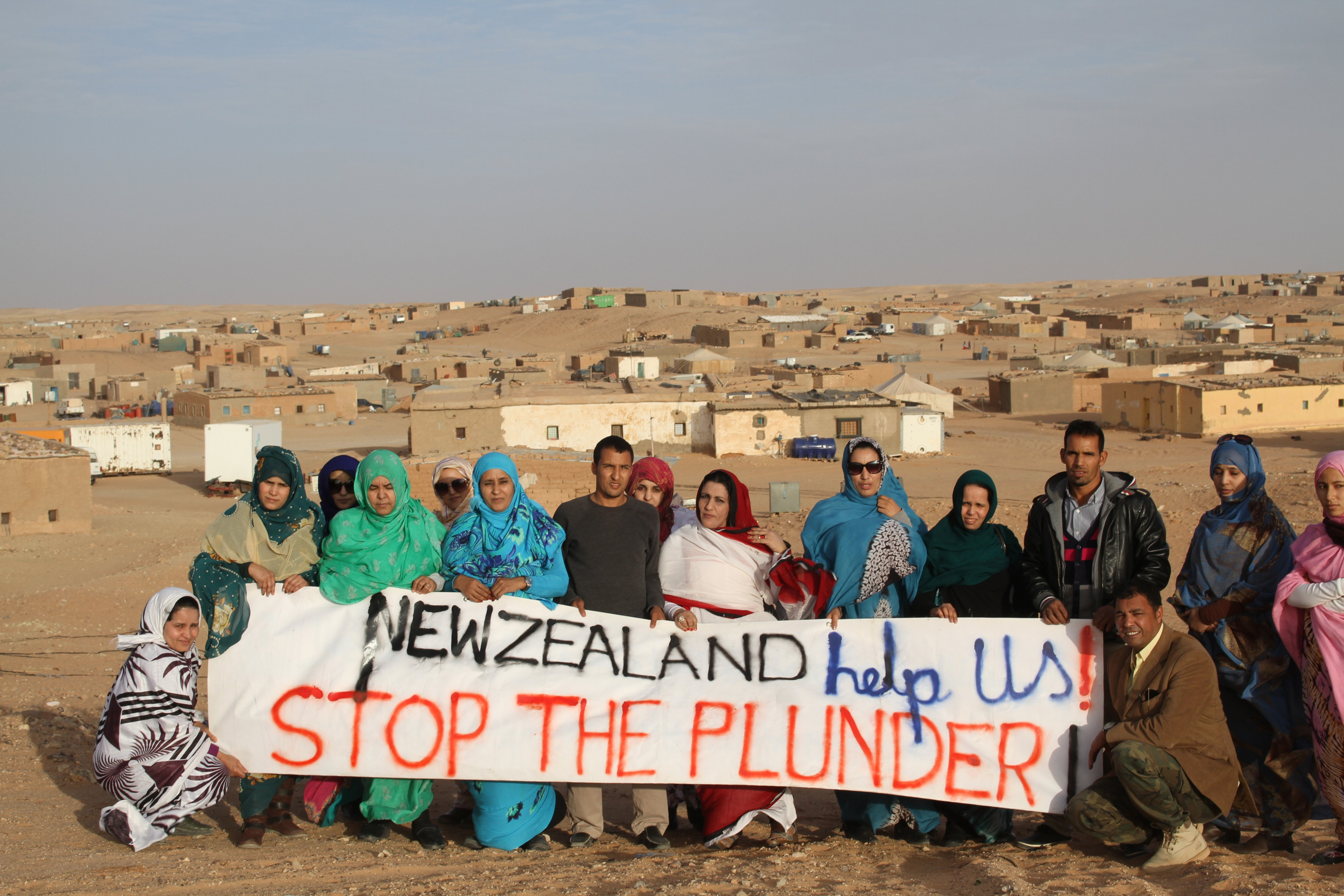 Saharawi refugees living in El-Aiun camp near Tindouf, in Algeria, protest against New Zealand's...