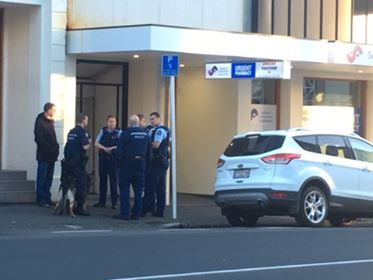 Police at the scene in Filleul St this morning. Photo: George Block