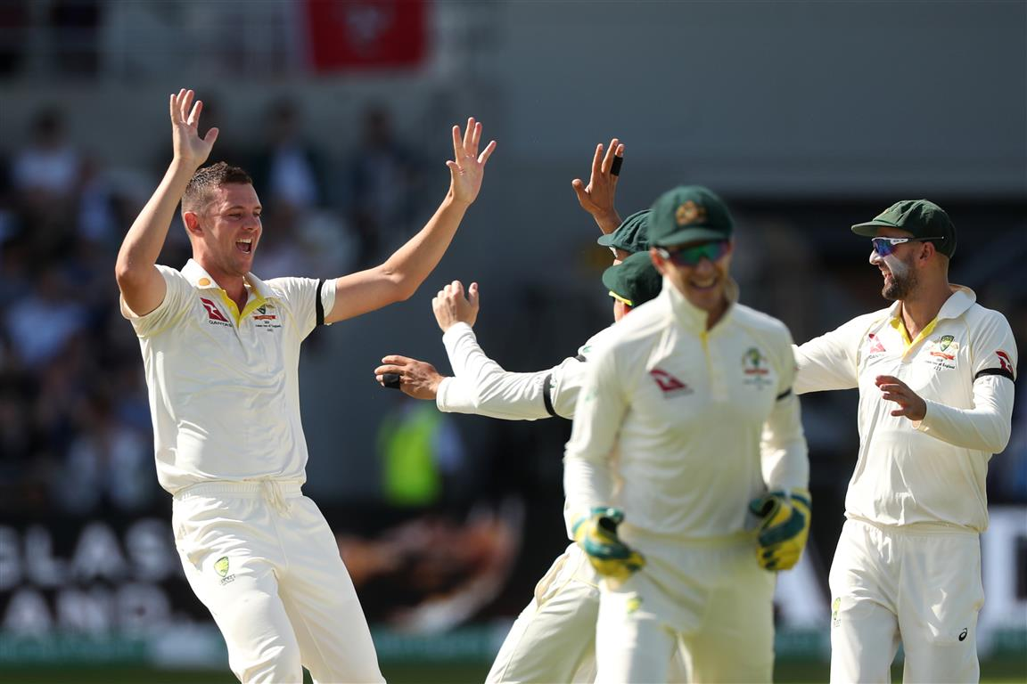 Australia's Josh Hazlewood celebrates taking the wicket of England's Joe Root. Photo: Reuters