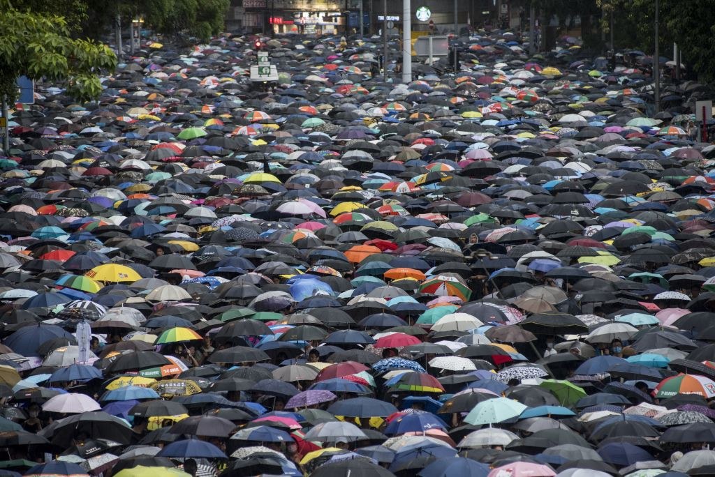 Thousands of demonstrators gather in the Victoria Park area during a protest in Hong Kong on...