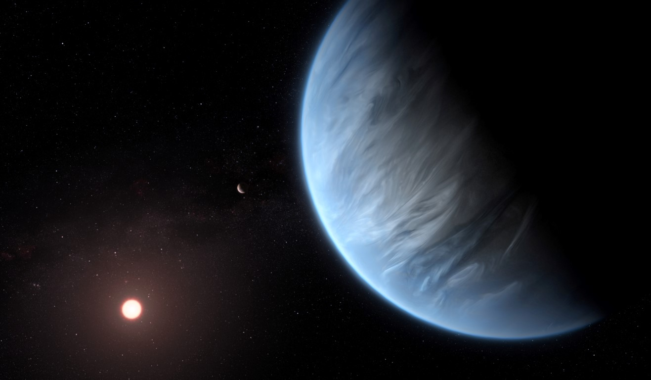An artist's impression shows the planet K2-18b, its host star and an accompanying planet....