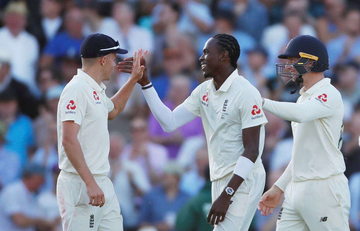 Jofra Archer celebrates with teammates after taking the wicket of Australia's Peter Siddle. Photo...