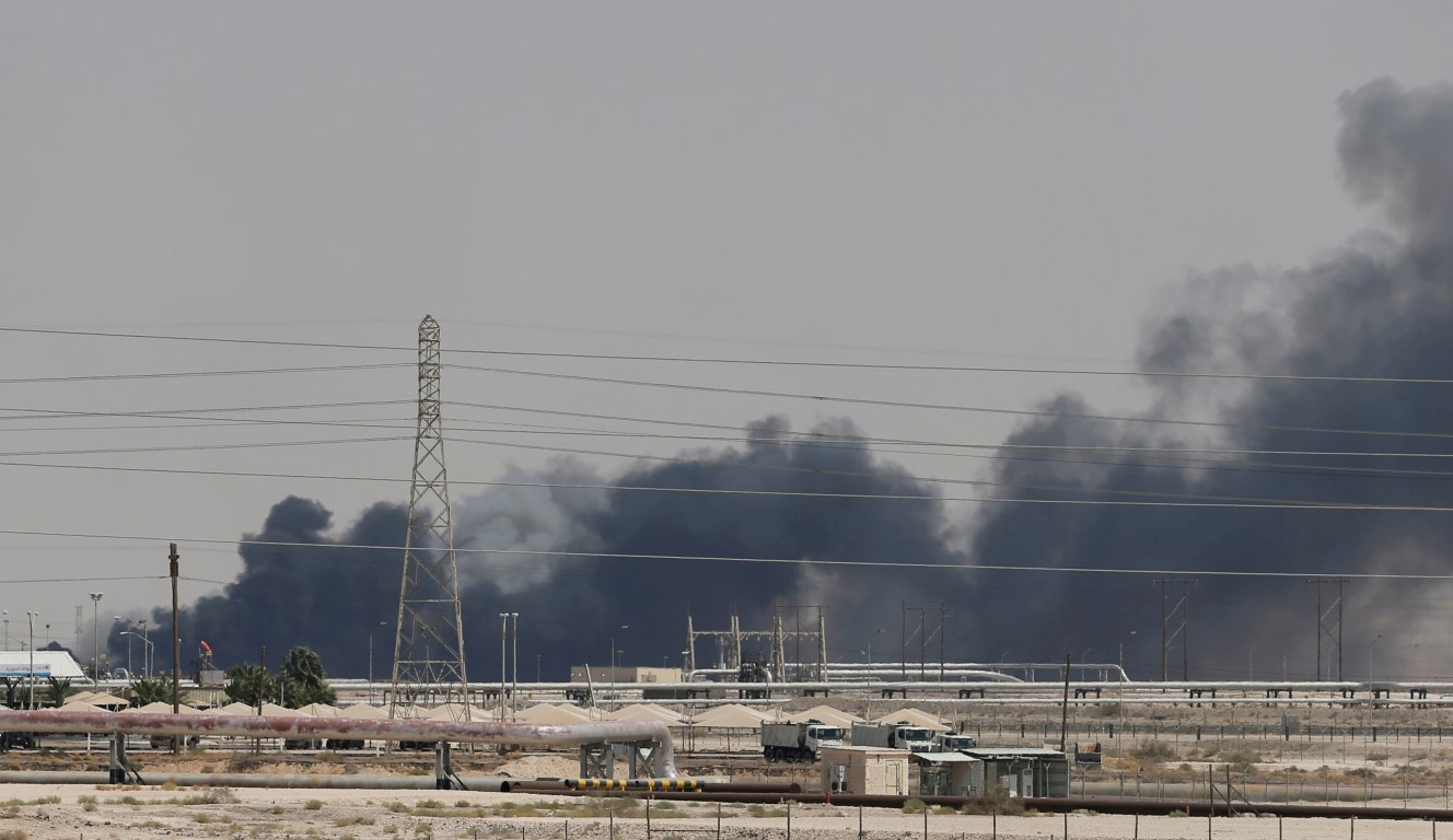 Smoke rises from a fire at the Aramco facility in the eastern city of Abqaiq following the attack...