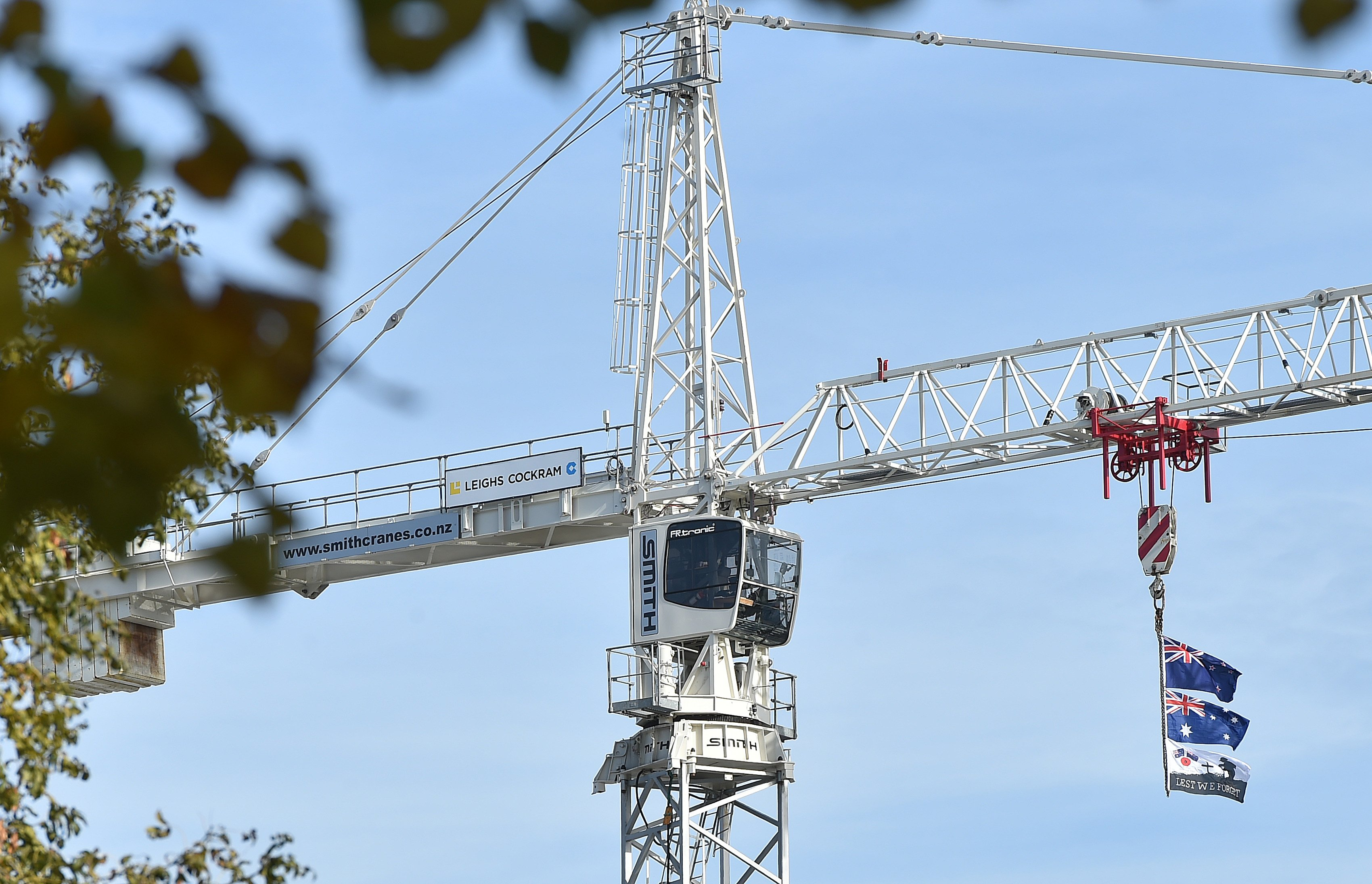 New Zealand and Australian flags fly from the crane invoved in the construction of the Dental School in Dunedin on Anzac Day. PHOTO: Gregor Richardson