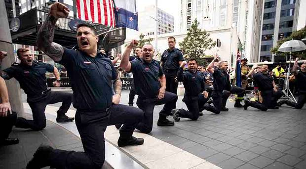 Firefighters perform a haka in memory of first responders to the September 11 World Trade Centre...