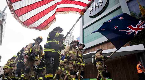 200 firefighters take part in a service and climbing of the Sky Tower in memory of the September...