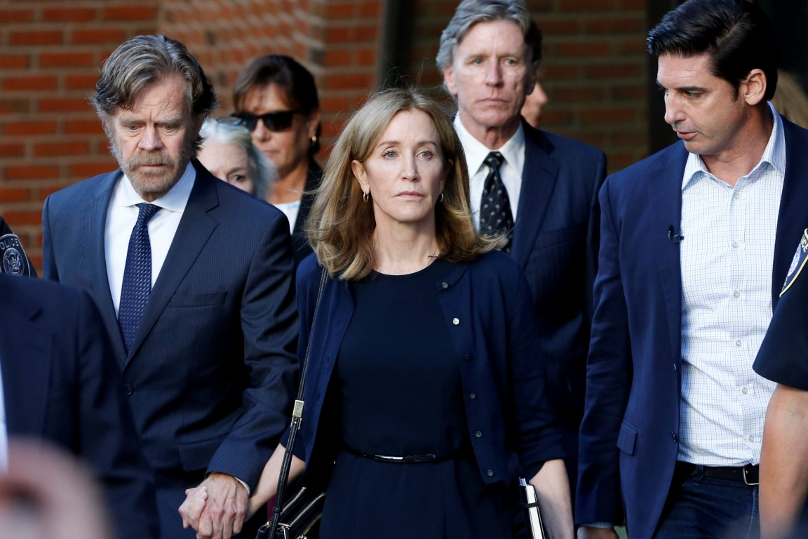 Felicity Huffman leaves the federal courthouse in Boston, Massachusetts with her husband William...