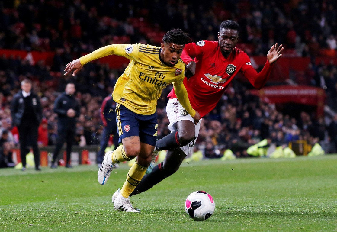 Manchester United's Axel Tuanzebe (L) in action with Arsenal's Reiss Nelson. Photo: Reuters