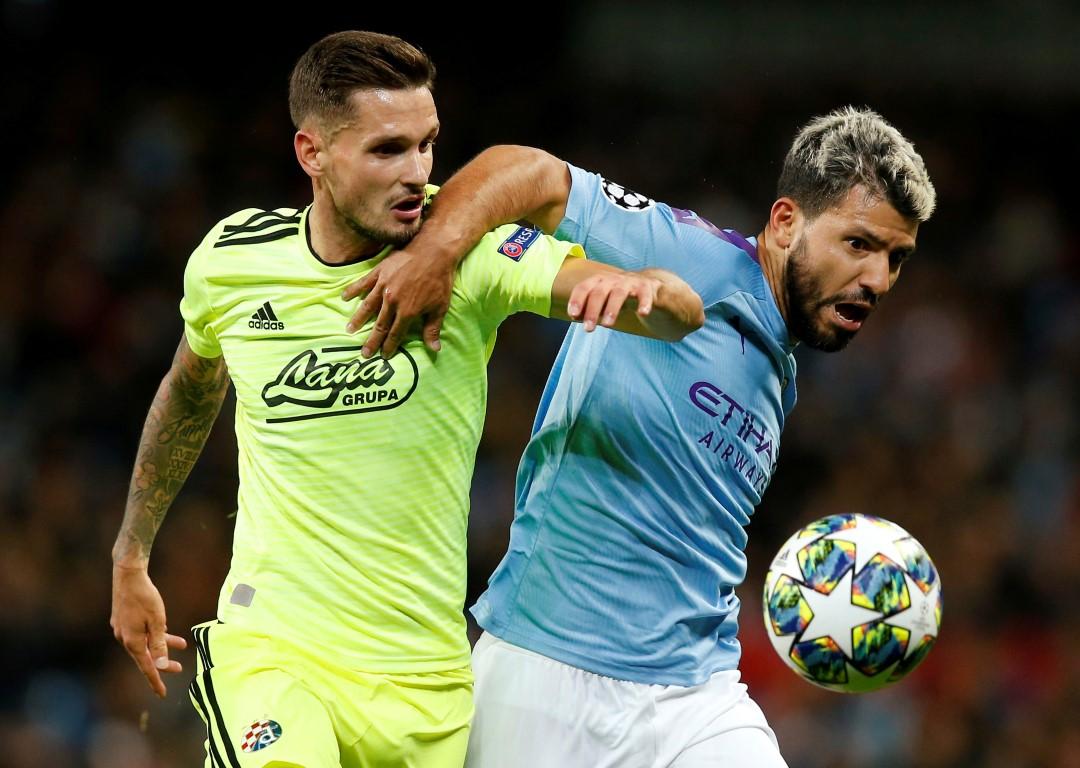 Manchester City's Sergio Aguero (R) in action with GNK Dinamo Zagreb's Petar Stojanovic. Photo:...
