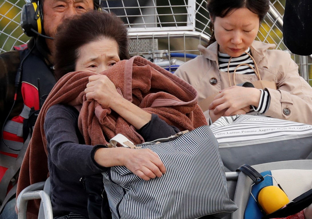 A woman reacts after she was rescued from a flooded area in Nagano Prefecture. Photo: Reuters
