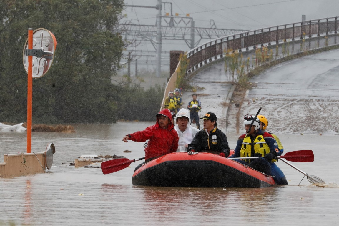 Rescue workers transport a resident in the aftermath of Typhoon Hagibis in Nagano Prefecture....
