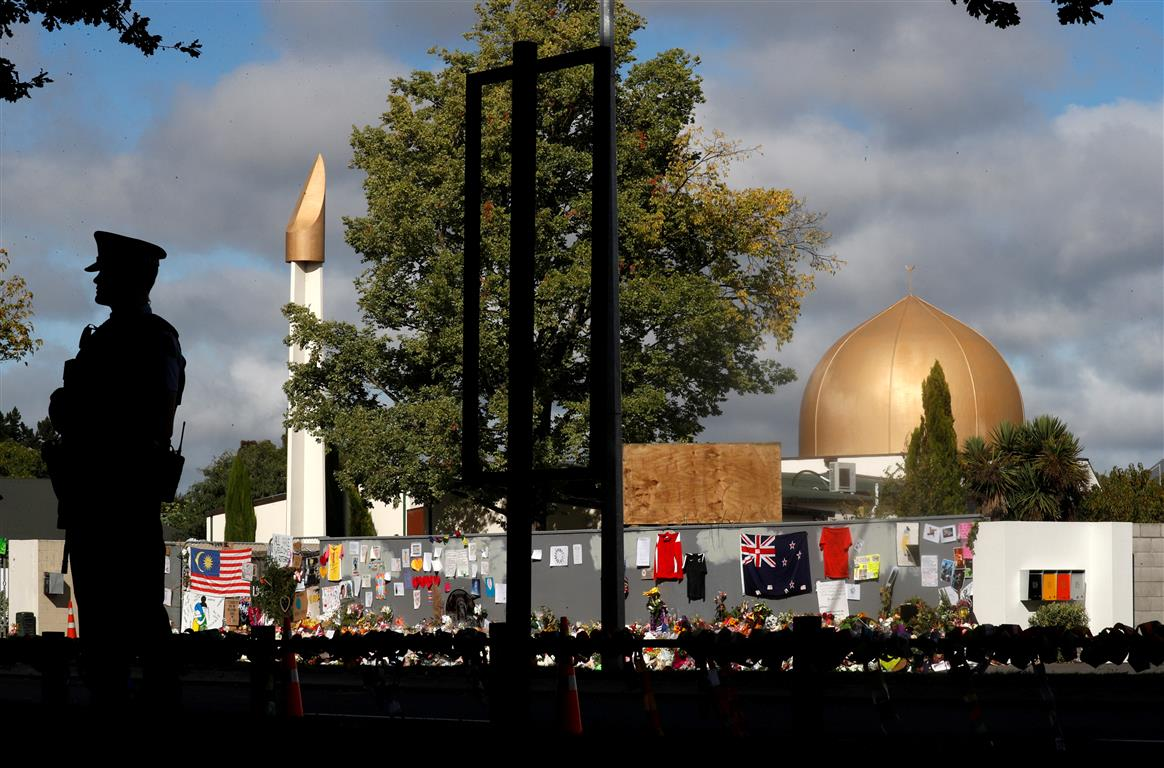 A police officer stands guard outside Al Noor mosque in Christchurch a week after the attacks in...