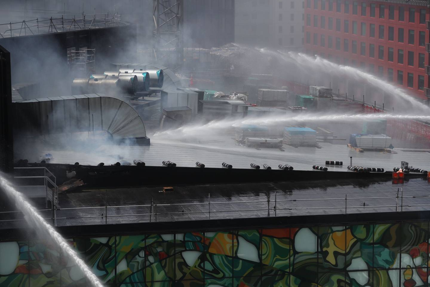 Firefighters are continuing to douse the roof of the Convention Centre. Photo: NZ Herald
