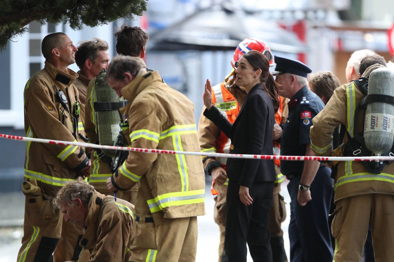 Prime Minister Jacinda Ardern meets firefighters battling the SkyCity blaze yesterday. Photo: NZ...
