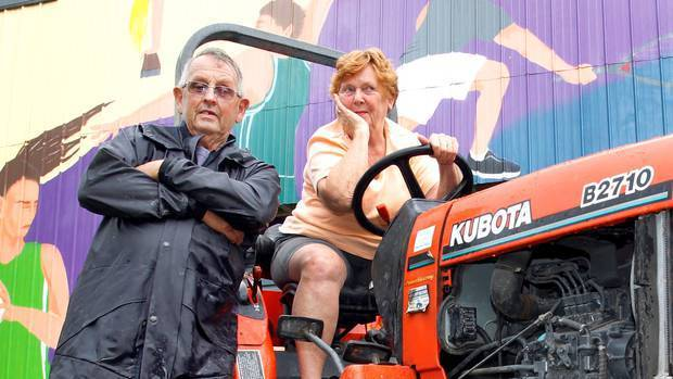Mark and Pam Ottaway in Kaiwaka with their little Kubota tractor which was stolen and involved in...