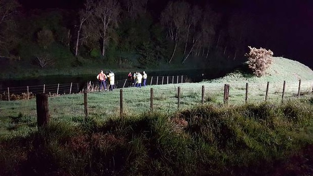 Police at the scene of the Wairoa River crash. Photo: Bay of Plenty Times