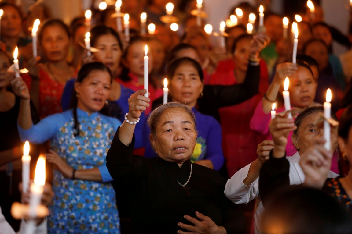 People attend a mass prayer for the victims at My Khanh parish in Nghe An province, Vietnam....