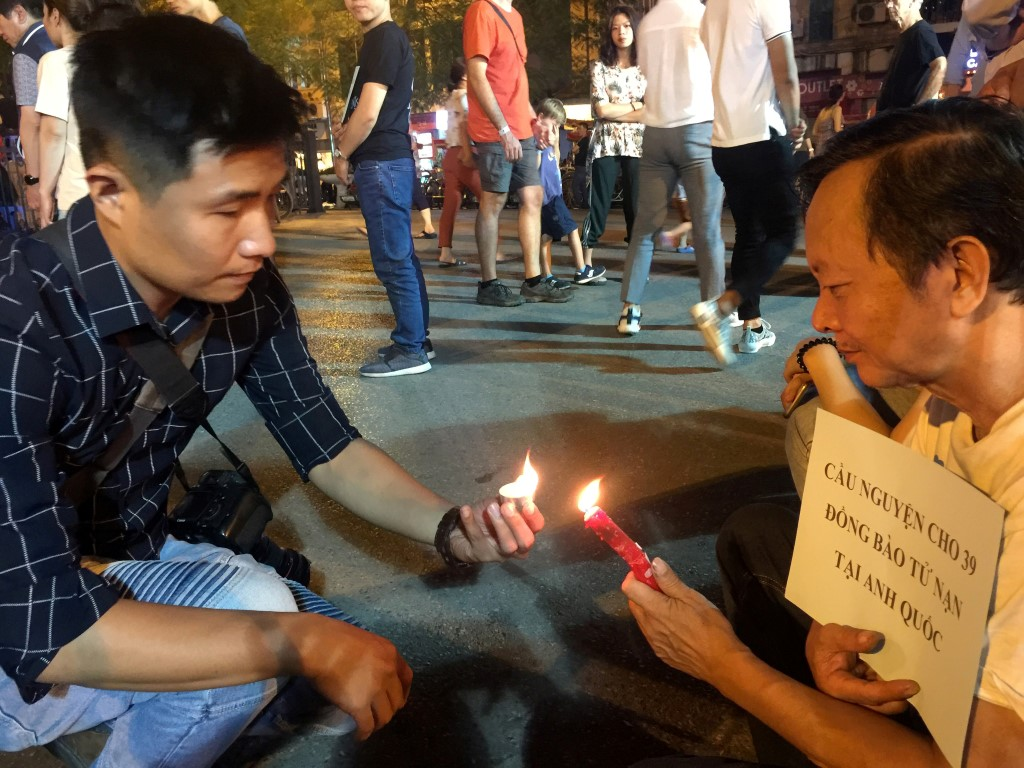 People light candles during a prayer for the 39 victims at Hanoi Cathedral in Vietnam. Photo:...