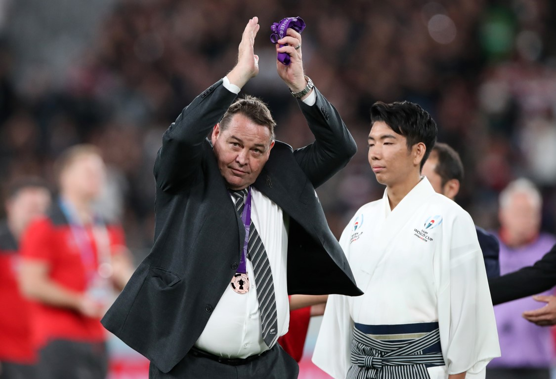 All Blacks head coach Steve Hansen acknowledges the crowd after receiving a bronze medal at the...