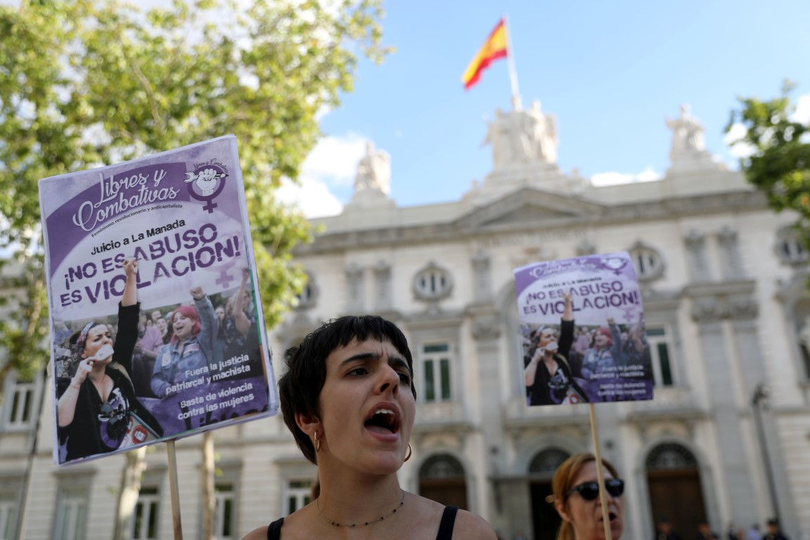 Women gather outside the Supreme Court in Madrid after Spain's top court found five men known as...