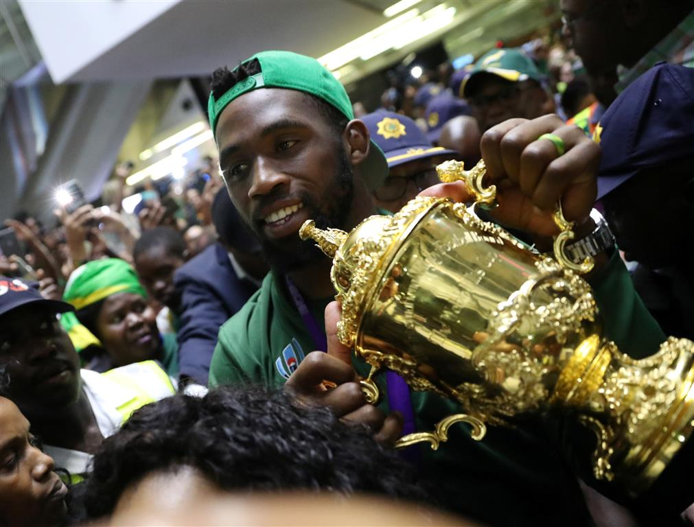 South Africa's Siya Kolisi with the Webb Ellis Cup after arriving at O.R. Tambo International...