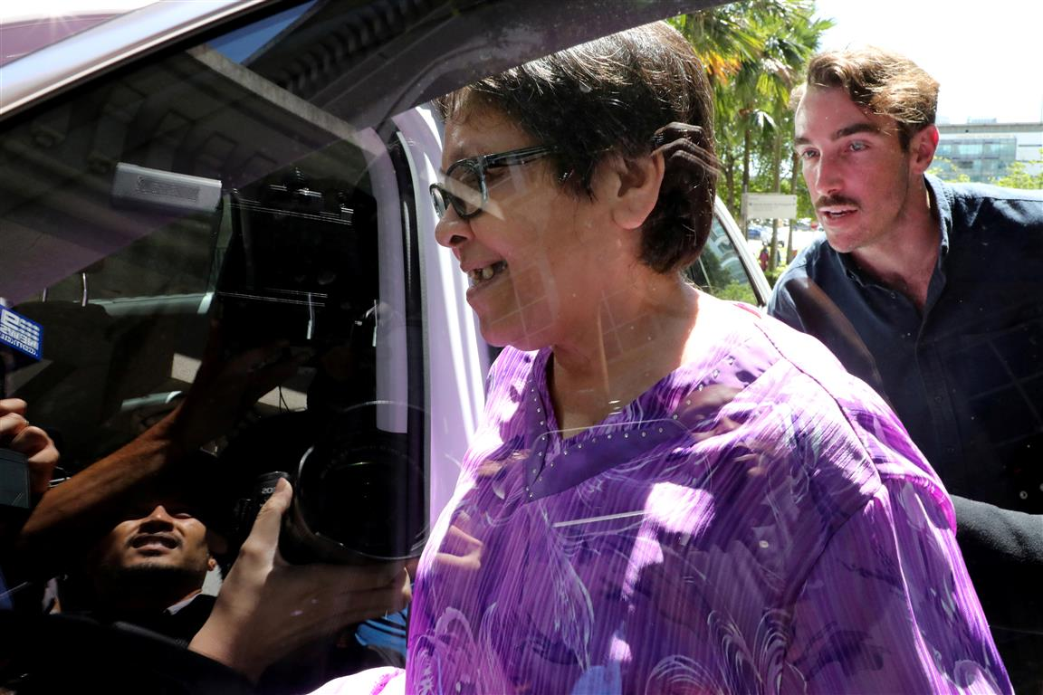 Maria Exposto enters a car after she was acquitted at the Federal Court in Kuala Lumpur. Photo:...
