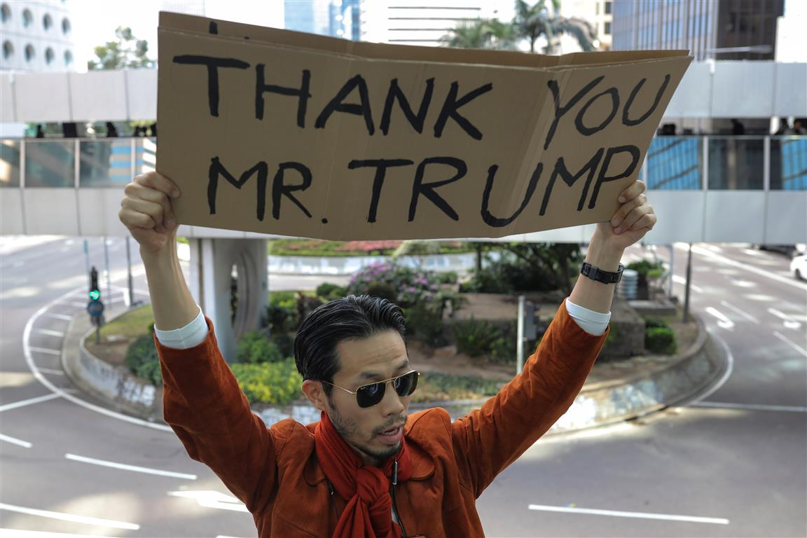 A man holds a placard during a lunchtime protest in Hong Kong on Thursday. Photo: Reuters