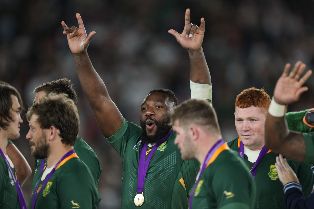 South Africa's Tendai Mtawarira celebrates with his winners medal after their Rugby World Cup...