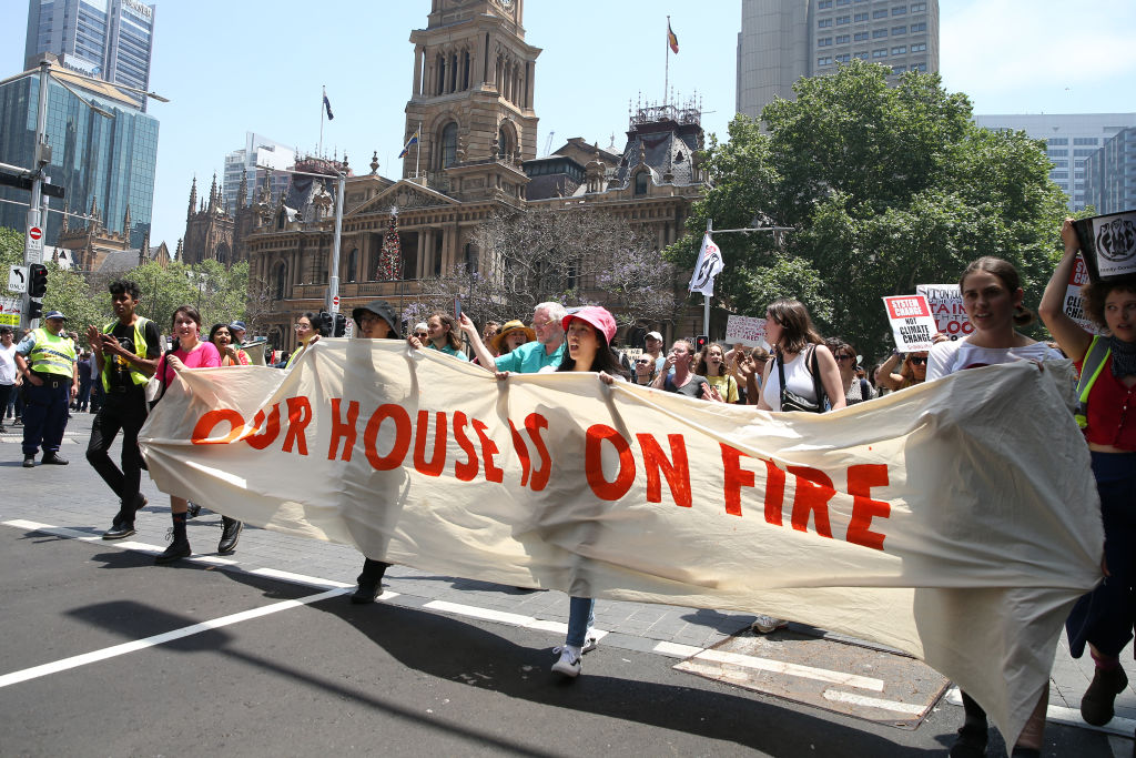 Protesters march through the streets of the Sydney CBD today. Photo: Getty