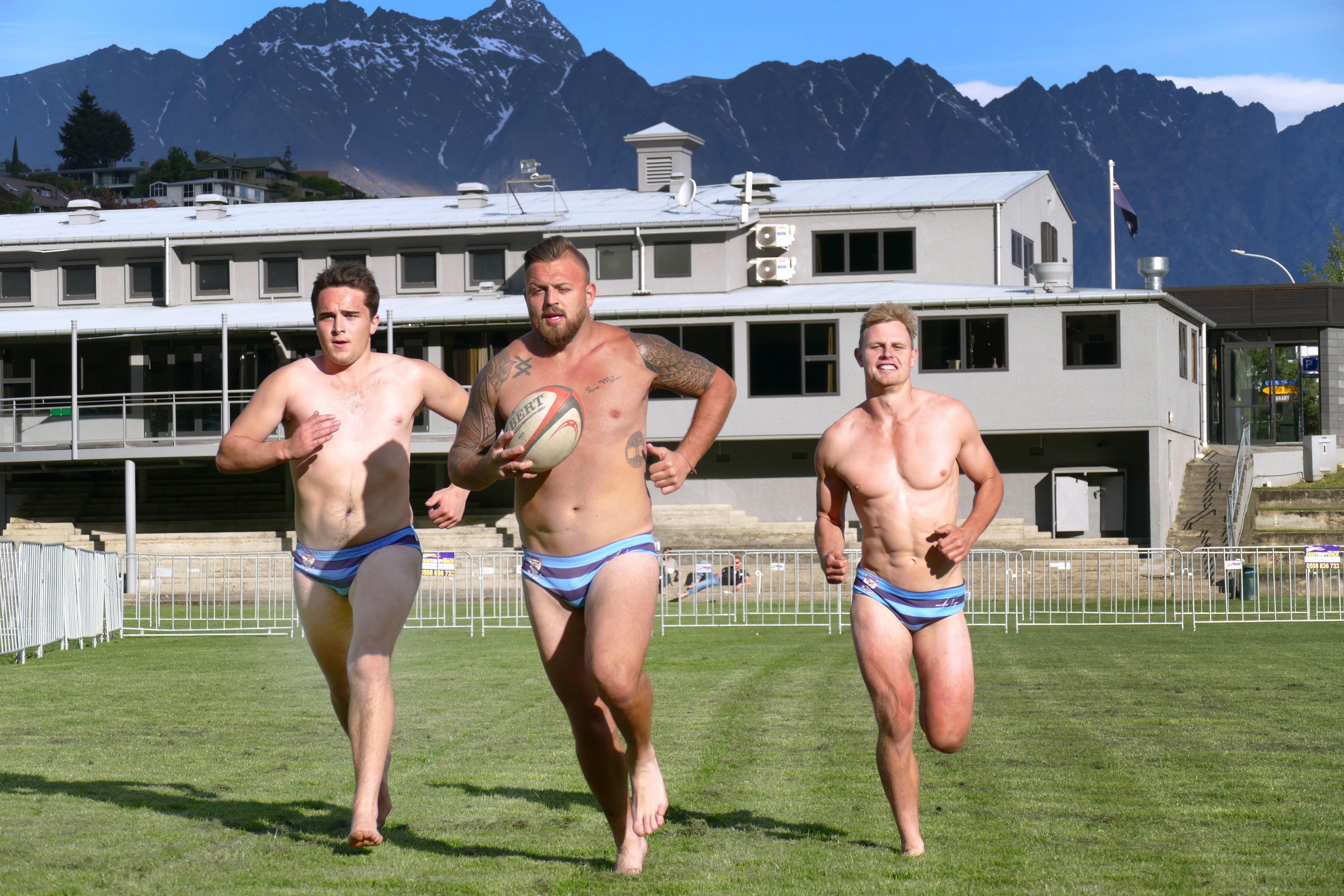 Wakatipu Rugby Club players (from left) Tom Ellis, Rhys Kearton and Logan Beggs stretch their legs before Saturday's Queenstown International Marathon. Photo: Tracey Roxburgh