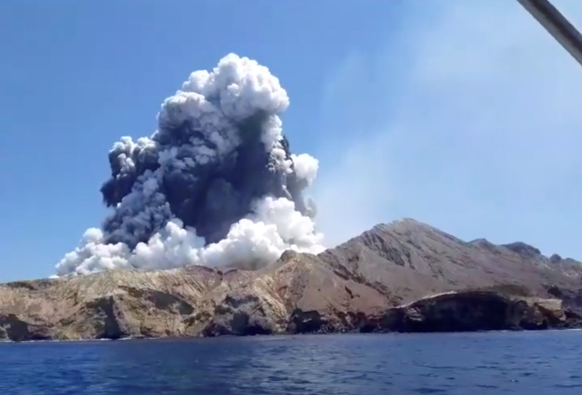 The eruption is seen from a boat near the island. Photo: INSTAGRAM @ALLESSANDROKAUFFMANN/via REUTERS