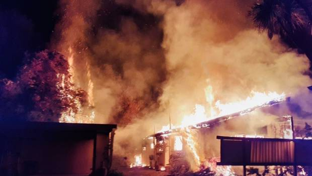 A firefighter was treated for heat exhaustion while battling a massive house fire in Nelson in...
