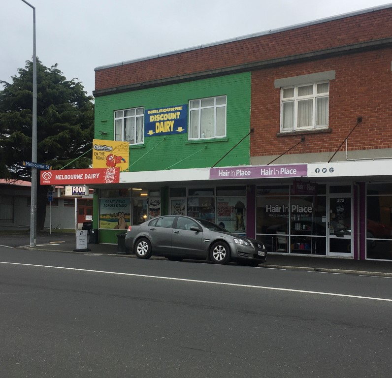 A man has been arrested after an alleged armed robbery at the Melbourne Dairy in South Dunedin....