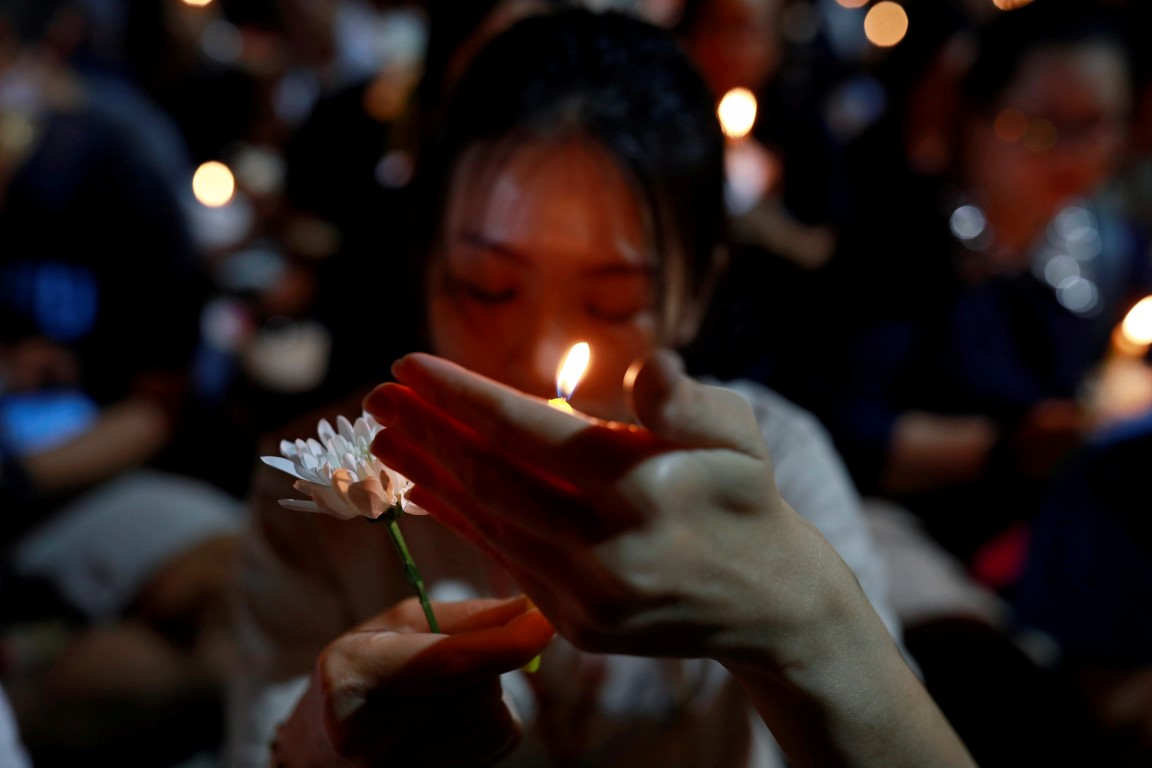 A woman attends a vigil for victims of the shooting in Nakhon Ratchasima, Thailand. Photo: Reuters